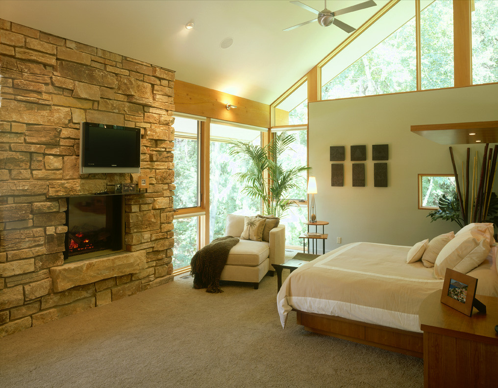 Bedroom stone fireplace - Edina Home Remodel Erotas Building Corporation Vaulted Master Bedroom Stone Fireplace Raised Hearth