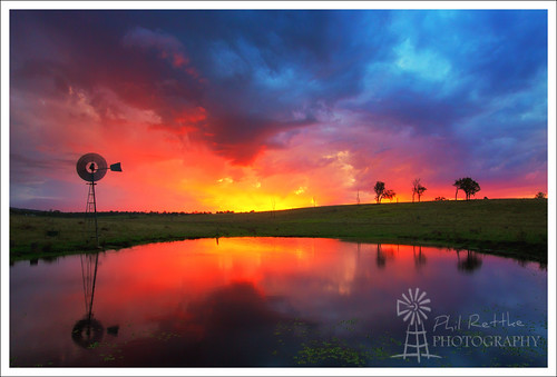 sunset reflection water windmill se glow dam south east qld queensland ipswich