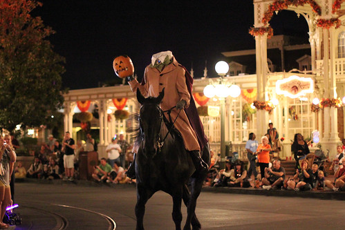 The Headless Horseman rides before the Boo To You Parade