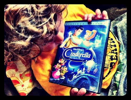 My son clutching his prized copy of Cinderella