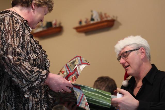 Grandma and Grandpa opening a present