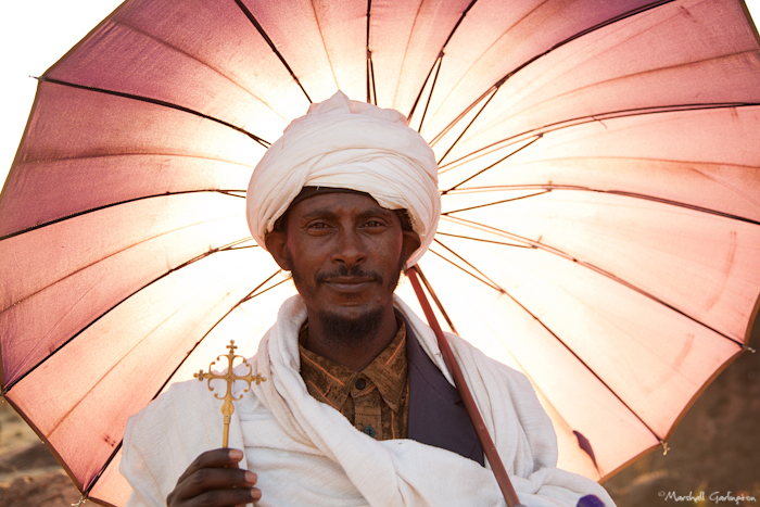 Priest with umbrella