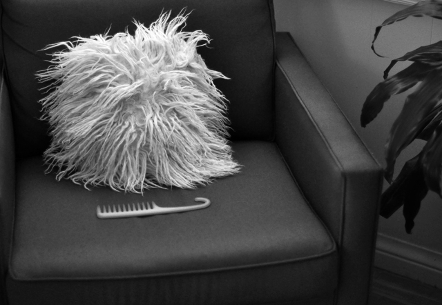 mongolian fur pillow after a year black and white