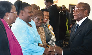 President Robert Mugabe of Zimbabwe greeting ZANU-PF officials at a Politburo meeting of the ruling party of this Southern African nation. Zimbabwe has set a standard for dealing with imperialism and neo-colonialism on the continent. by Pan-African News Wire File Photos