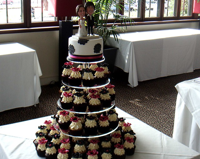 Hot pink and black wedding cupcakes Customised toppers decorated this cute