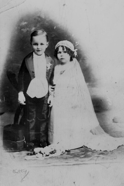 Reginald Hartigan and Clarice Johnson playing dressups in wedding costume