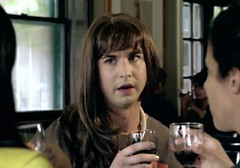 screen shot from Shit Girls Say: Guy in a wig holding a drink