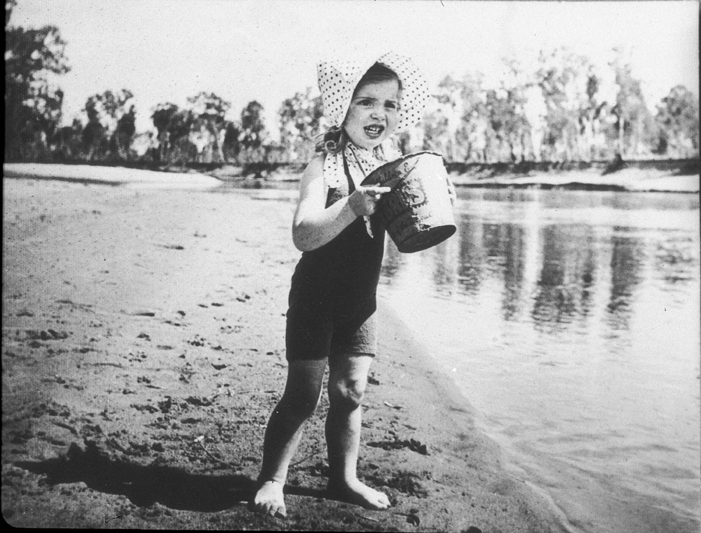 Girl (Meredith Binns) on the Murray River. The bucket advertises