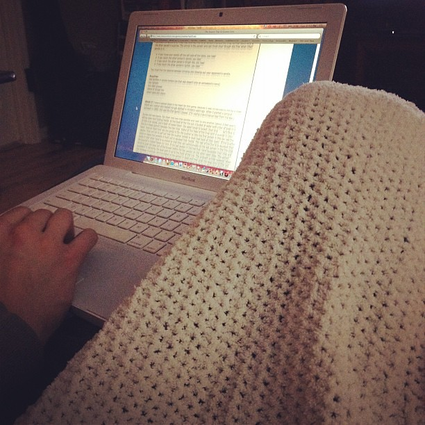 Curled up on the couch under a blanket while Collin plans for youth group.
