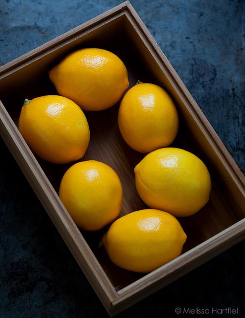 meyer lemons in a wooden box