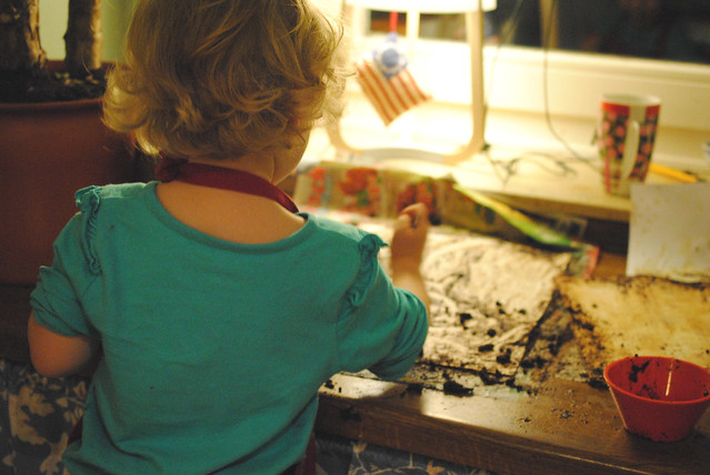 E helping with coffee stained paper
