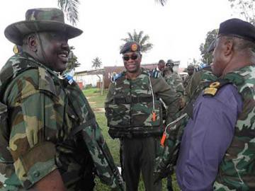 Nigerian military forces share a joke while occupying the capital of Lagos. The Federal Government deployed troops to ban protests after a unilateral settlement was imposed on labor after a one week general strike. by Pan-African News Wire File Photos