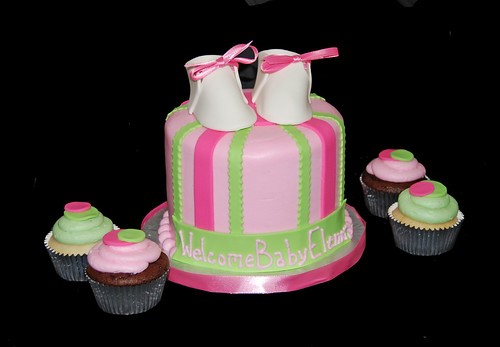pink and green baby shower cupcake tower with booties