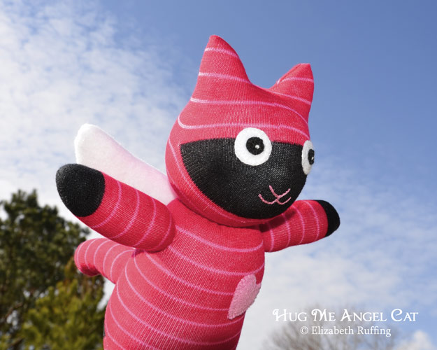 Red-and-pink striped Hug Me Angel Cat Sock Kitten, original art toy by Elizabeth Ruffing