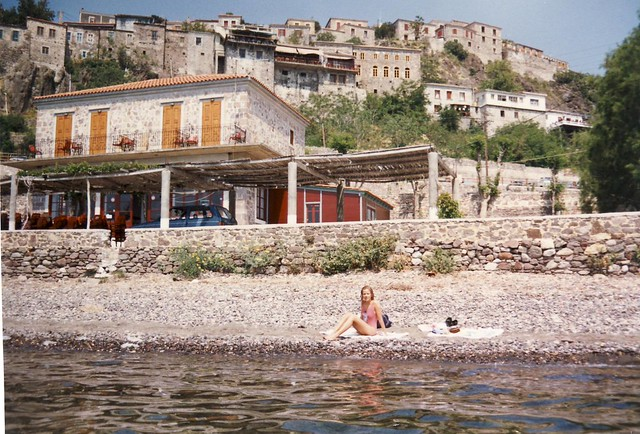 Sunning at the rocky beach in Plomari on the island of Lesbos, Greece