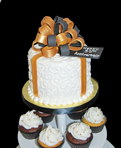 black and gold 50th wedding anniversary cupcake tower