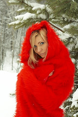 fictional character(0.0), santa claus(0.0), costume(0.0), fur(1.0), clothing(1.0), winter(1.0), fur clothing(1.0), red(1.0), outerwear(1.0), photo shoot(1.0), long hair(1.0),