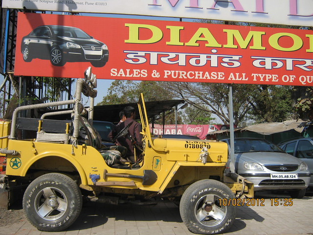 Yellow Jeep for Sell - Visit Kumar Properties' Kumar Purab, 2 BHK & 3 BHK Flats, off Pune Solapur Road, behind Diamond Cars, Hadapsar, Pune 411 028