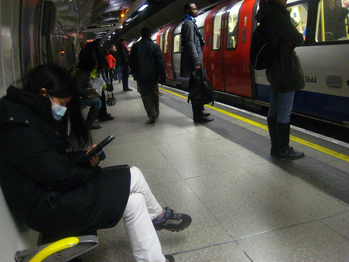 Flu mask on the London Underground by Annie Mole