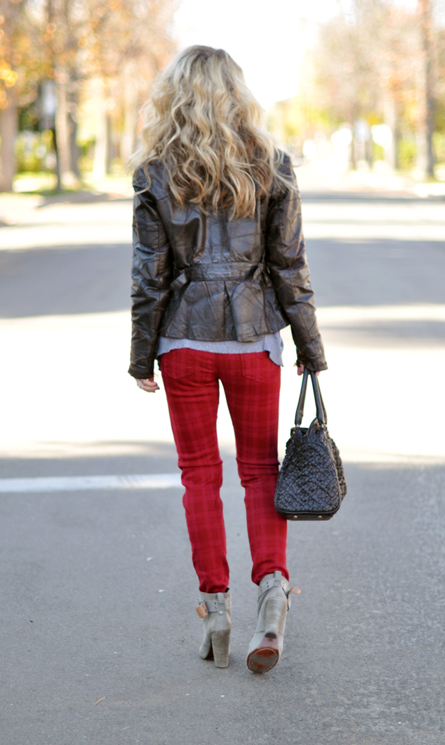 back of red jeans-big hair-patchwork leather jacket