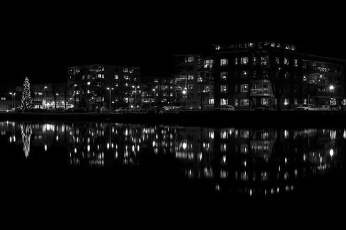 city homes windows blackandwhite black water buildings reflections dark lights evening trollhättan