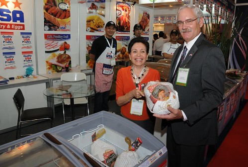 Acting Under Secretary for Farm and Foreign Agricultural Services Michael Scuse meets with Magaret Say of the USA Poultry Export Council's Singapore office at the 11th Food and Hotel Indonesia show in Jakarta April 6, 2011. As part of USDA's agricultural trade mission to Indonesia, Scuse helped open the show, toured the floor and met with U.S. exhibitors. Photo By Rifky Suryadinata, U.S. Embassy, Jakarta