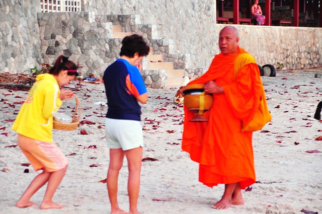Monk Receiving Morning Alms on Hua Hin Beach