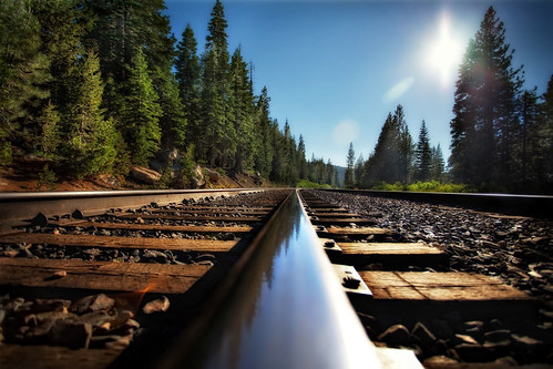 blue trees sun reflection lines traintracks perspective sierras karenhutton lochlevencrossing