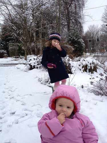 both girls eating snow