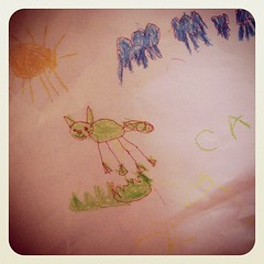 Cat (or possibly a pig?) in a sun shower. By Casey (5 yrs old)