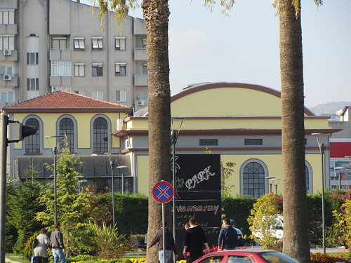 Balikesir: Old yellow building behind palm trees (2)
