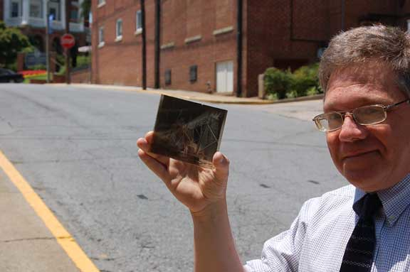Bob Flippen holds one of the glass negatives