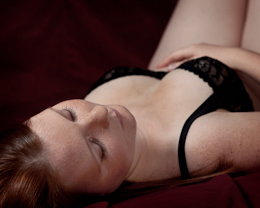 Ipswich woman poses for boudoir nudes photography.