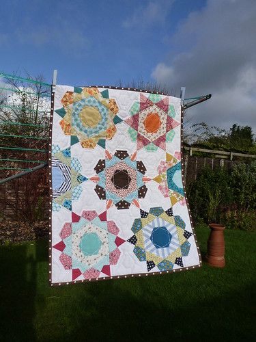rose star paper pieced quilt