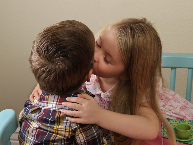Kissing her little brother - showing affection