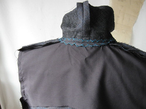 Grey jacket cross-stitch inner collar