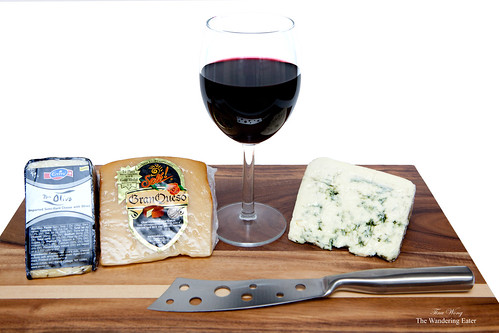 Gran Queso, Don Olivo, and Buttermilk Blue cheeses with a glass of Pinot Noir