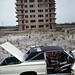 More 1970s New York fun! An abandoned 1960s Ford Thunderbird with broken-out windows and a torn vinyl roof. Abandoned apartment building completes the scene. Breezy Point. Queens.  June 1973 by wavz13