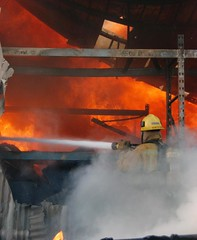 L.A. Firefighters Battle Pacoima Industrial Fire. © Photo by Mike Meadows. Click to view more...