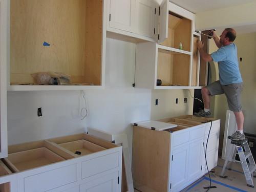 Josh installs the cabinets
