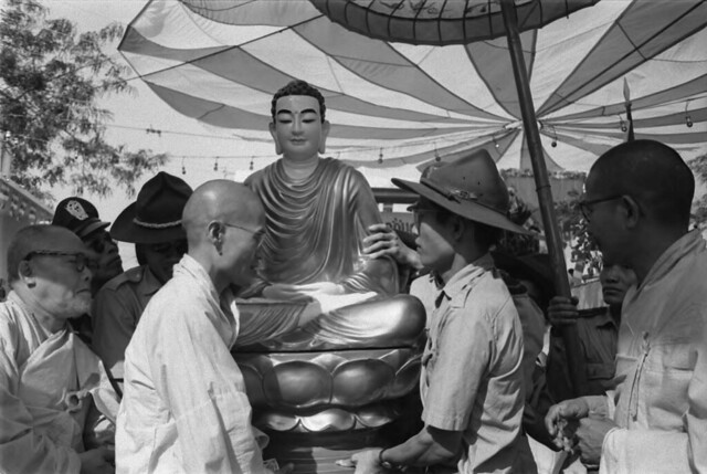 SAIGON, 09 Jan 1965 - Vietnamese air force soldiers attending Buddhist ceremony with head monk Tam Chau.