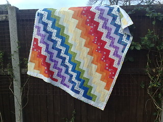 Evies quilt finished on fence 2