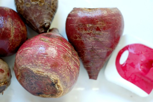 Scrubbing the beets before roasting by Eve Fox, Garden of Eating blog, copyright 2011