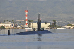 PEARL HARBOR (Dec. 14, 2011) Los Angeles-class submarine USS Tucson (SSN 770) departs Joint Base Pearl Harbor-Hickam for a scheduled six month Western Pacific deployment. (U.S. Navy photo by Mass Communication Specialist 2nd Class Ronald Gutridge)
