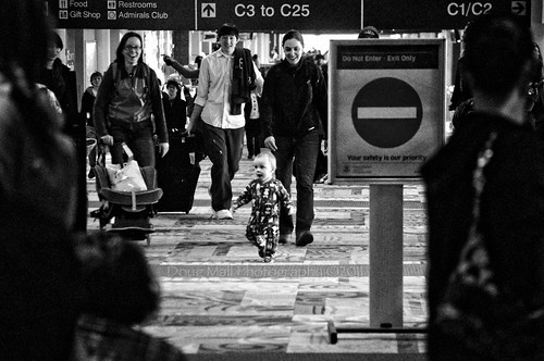 travel bw reunion airport toddler holidays emotion 25daysofchristmas nikond5000 dougmall getpushed dorothealangetype
