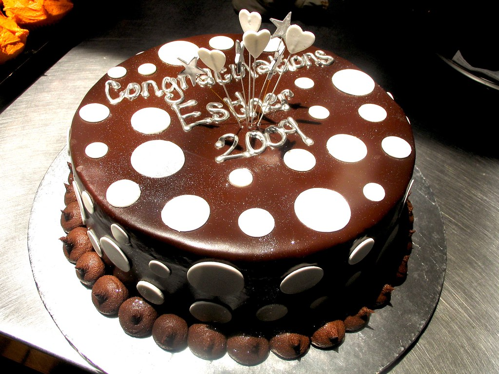Wicked Chocolate cake decorated with piped silver wording ...