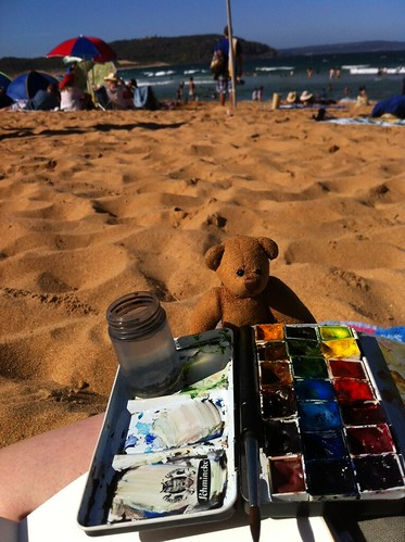 Someone is at the beach trying to sketch