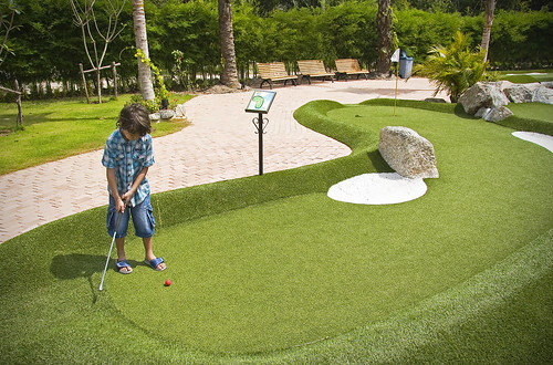 Teeing off at the Mini Golf at Bang Tao Beach