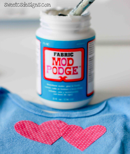 GENIUS! Use fabric mod podge and some cute fabrics to quickly turn baby boy clothes into a cute girl wardrobe! #modpodge