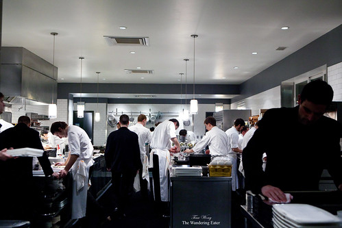 A brigade of chefs working at the kitchen